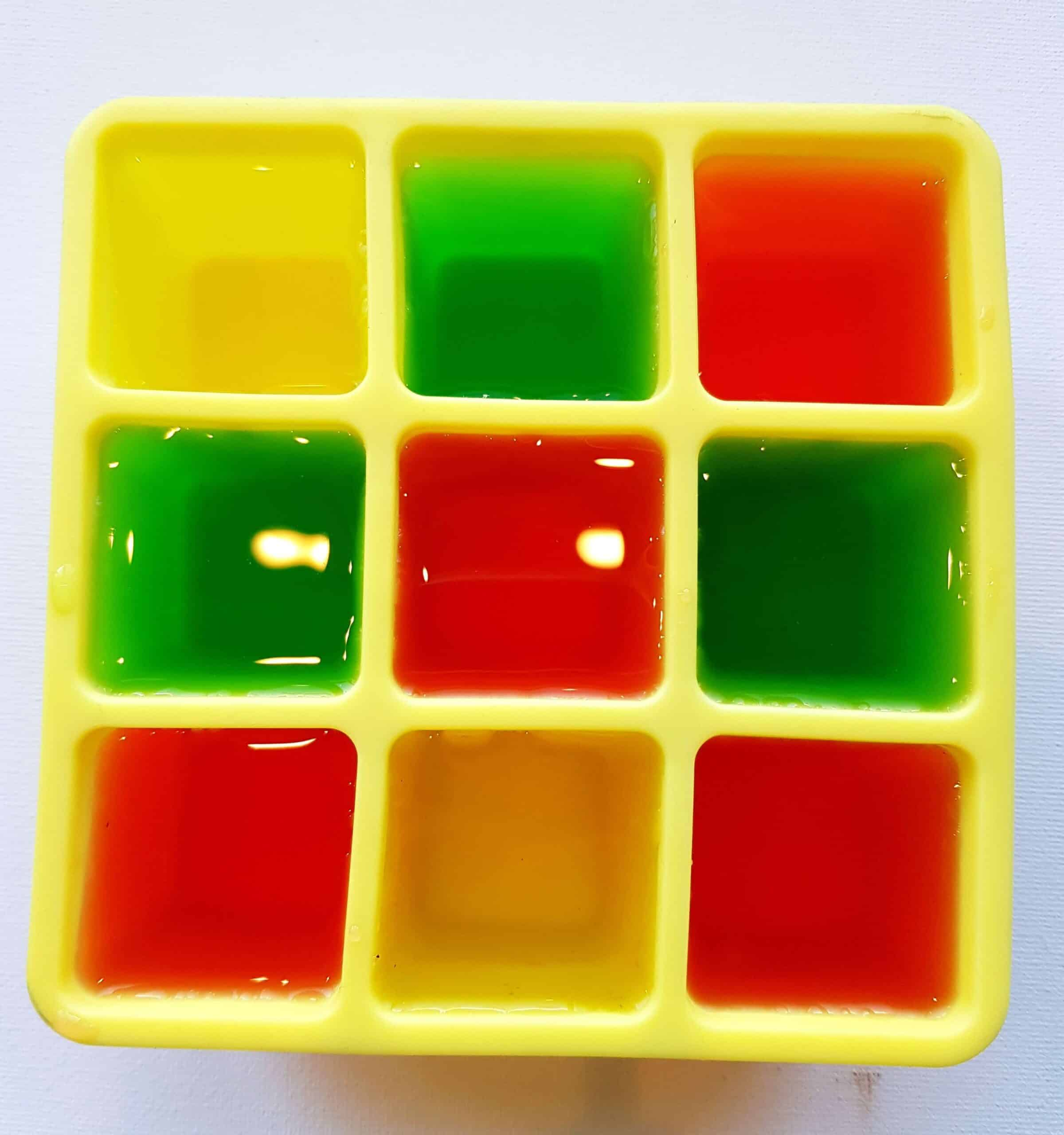 fill ice cube tray with colored water